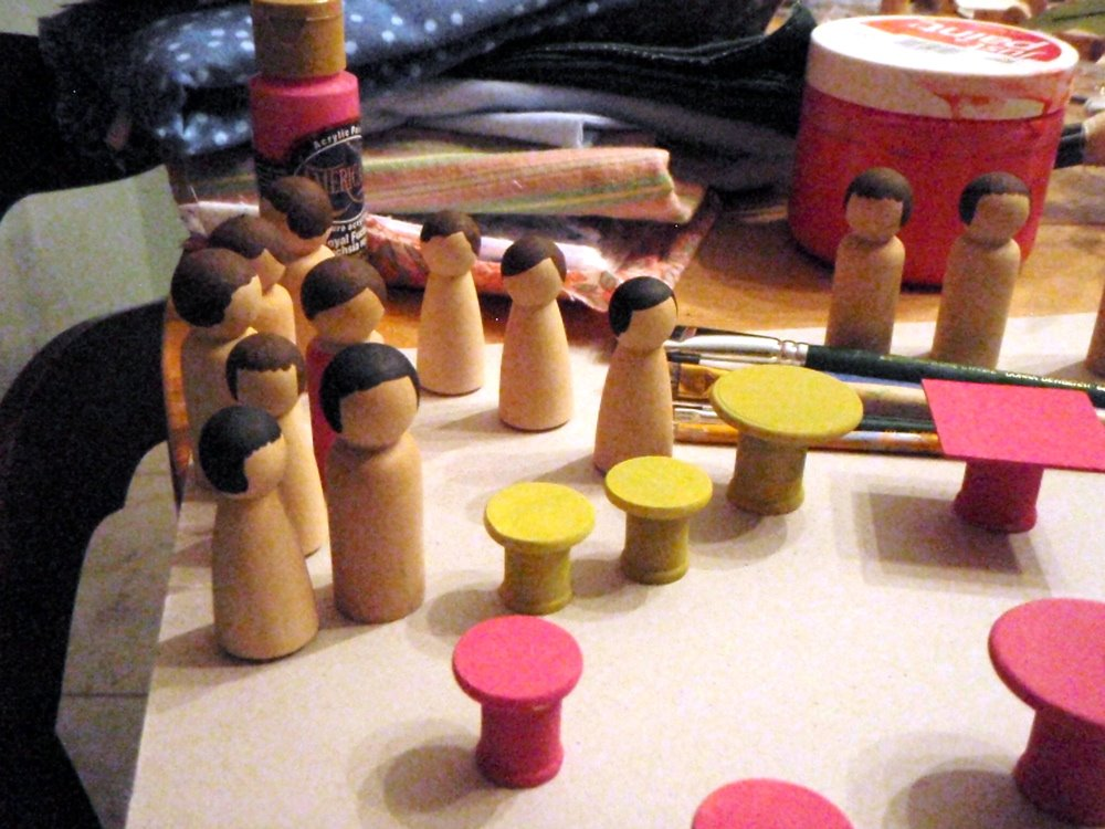 painting wooden peg dolls
